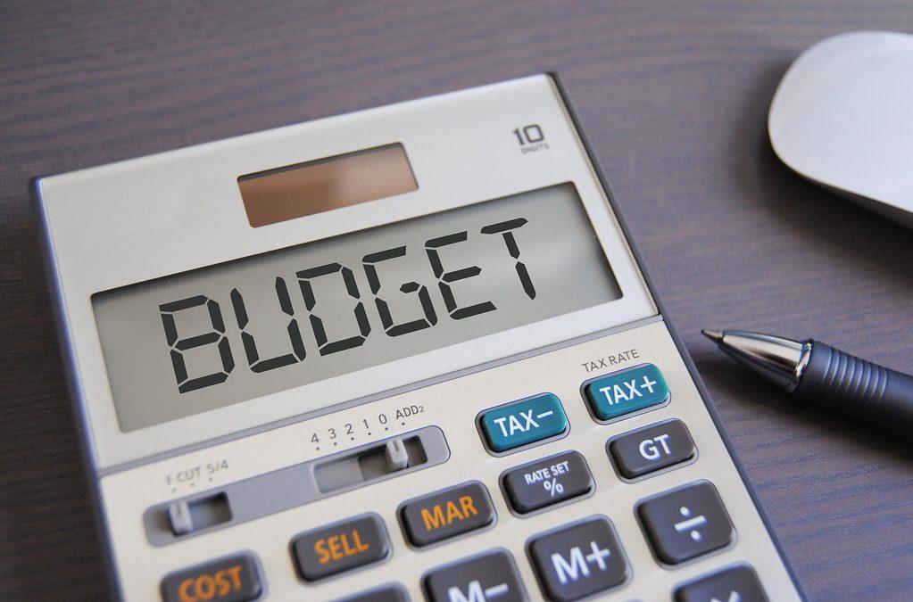 Budget written on a calculator - mini budget summary